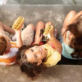 Lifestyle of kids eating hot dogs