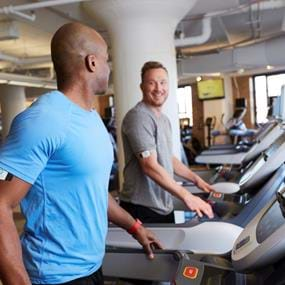 RefreshinQ friends working out on treadmills