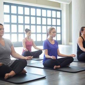 RefreshinQ group of women in yoga class lifestyle photography
